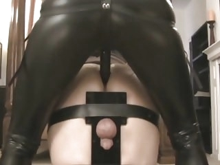 femdom bdsm Domina fucks him with strapon